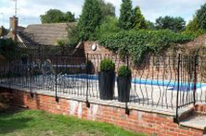 Iron gates around swimming pool